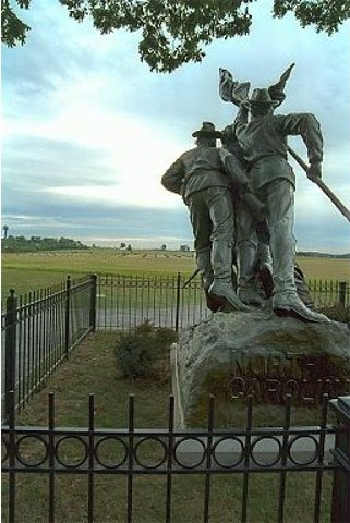 "North Carolina Monument. The view is from the Confederate position on Seminary Ridge. Looking straight ahead one can see the ""clump of trees"" on the horizon marking the approximate centre of the Union line. (Copyright Allen Goodall 2003)"
